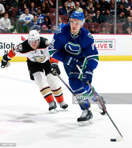 Corey Perry of the Anaheim Ducks checks Nikita Tryamkin of the Vancouver Canucks during their NHL game at Rogers Arena March 28 2017 in Vancouver...