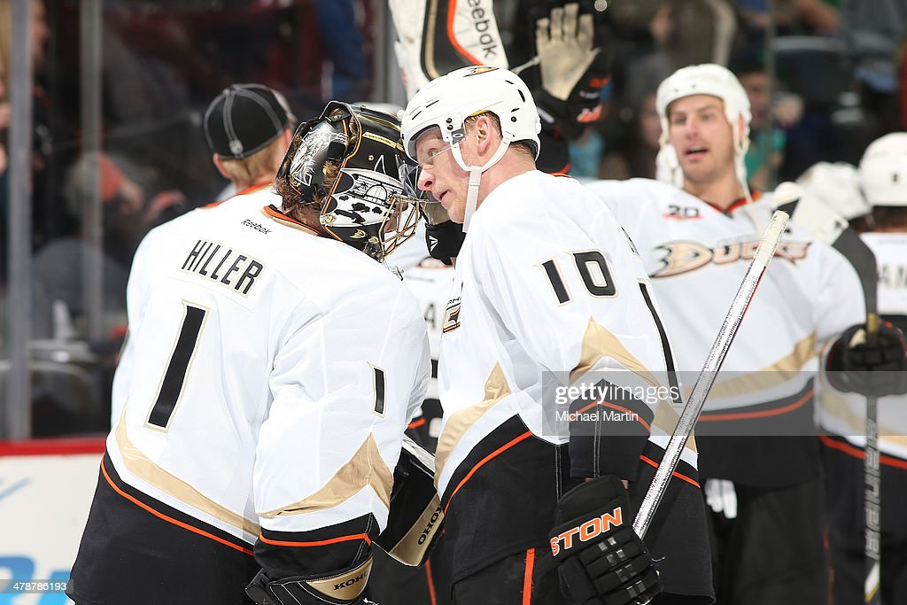Corey Perry #10 of the Anaheim Ducks congratulates goaltender Jonas Hiller #1 on a victory against the Colorado Avalanche at the Pepsi Center on March 14, 2014 in Denver, Colorado. The Ducks defeated the Avalanche 6-4.