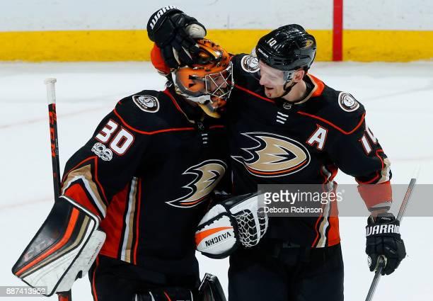 Corey Perry of the Anaheim Ducks congratulates Ryan Miller following his 40th shutout win against the Ottawa Senators on December 6 2017 at Honda...