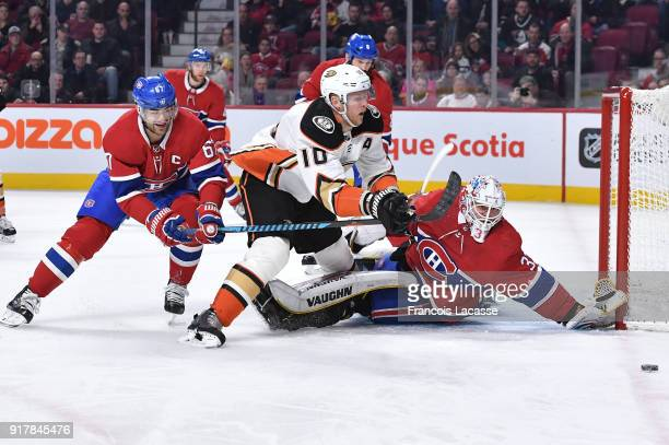 Corey Perry of the Anaheim Ducks controls the puck against Antti Niemi and Max Pacioretty of the Montreal Canadiens in the NHL game at the Bell...