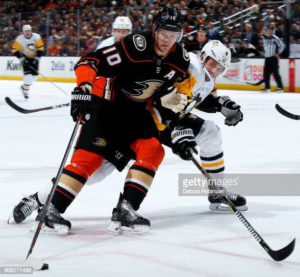 Corey Perry of the Anaheim Ducks controls the puck with pressure from Brian Dumoulin of the Pittsburgh Penguins during the game on January 17 2018 at...