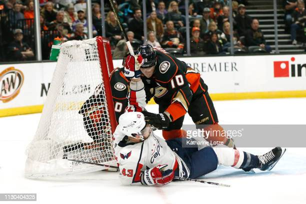Corey Perry of the Anaheim Ducks falls on Tom Wilson of the Washington Capitals near the Anaheim Ducks goal during the second period at Honda Center...