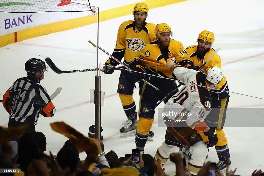 Corey Perry #10 of the Anaheim Ducks fights with Mike Fisher #12 and Mattias Ekholm #14 of the Nashville Predators after the Nashville Predators defeated the Anaheim Ducks 2-1 in Game Three of the Western Conference Final during the 2017 Stanley Cup Playoffs at Bridgestone Arena on May 16, 2017 in Nashville, Tennessee.