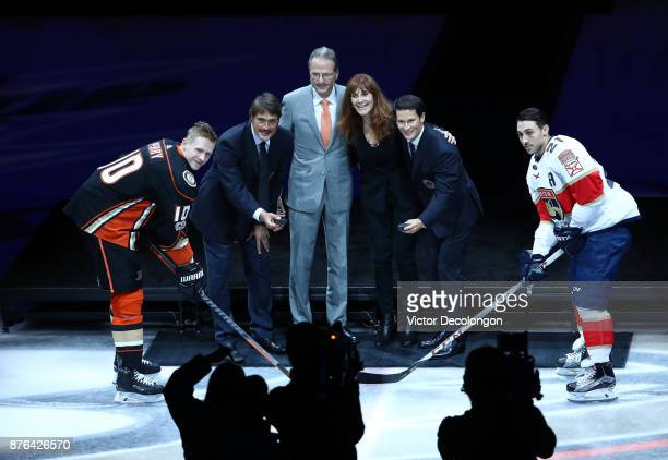 Corey Perry of the Anaheim Ducks former Ducks player Teemu Selanne Ducks owners Henry and Susan Samueli former Ducks player Paul Kariya and Vincent...