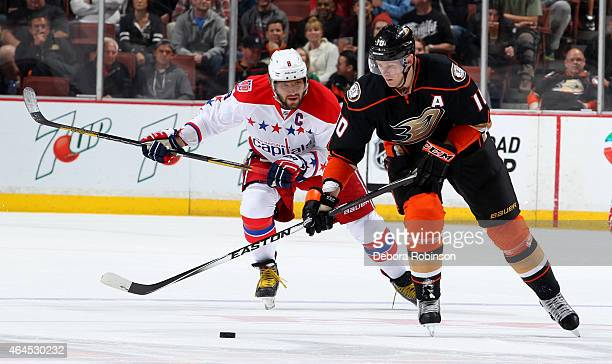 Corey Perry of the Anaheim Ducks handles the puck against Alex Ovechkin of the Washington Capitals on February 15 2015 at Honda Center in Anaheim...