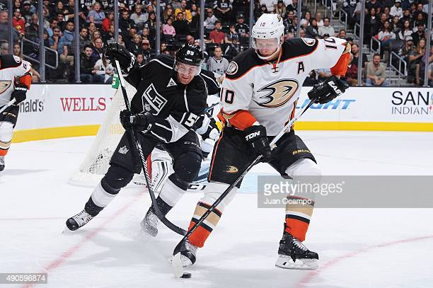 Corey Perry of the Anaheim Ducks handles the puck against Jeff Schultz of the Los Angeles Kings at STAPLES Center on September 29 2015 in Los Angeles...