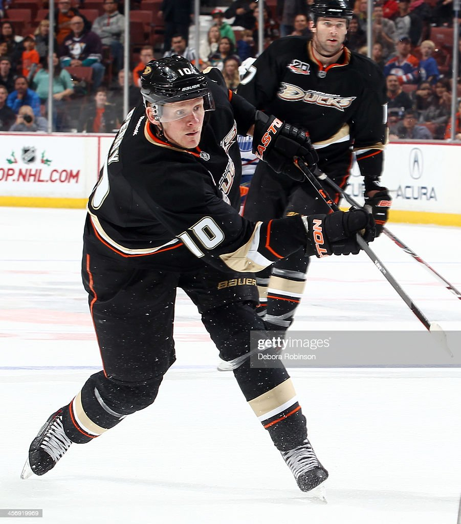 Corey Perry #10 of the Anaheim Ducks handles the puck during the game against the Edmonton Oilers on December 15, 2013 at Honda Center in Anaheim, California.