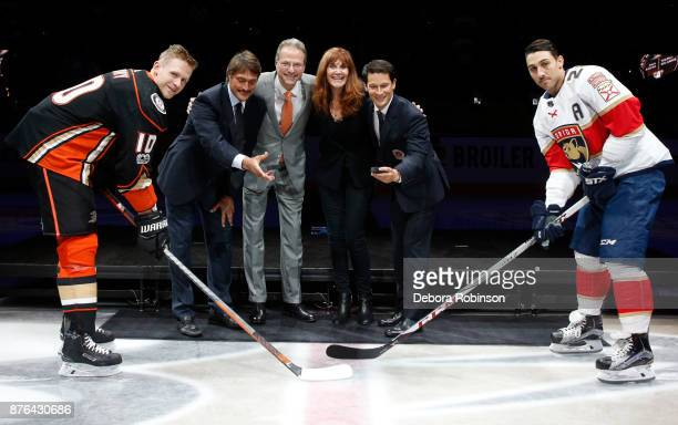 Corey Perry of the Anaheim Ducks left and Vincent Trocheck of the Florida Panthers right pose with Hockey Hall of Famers and former Anaheim Ducks...