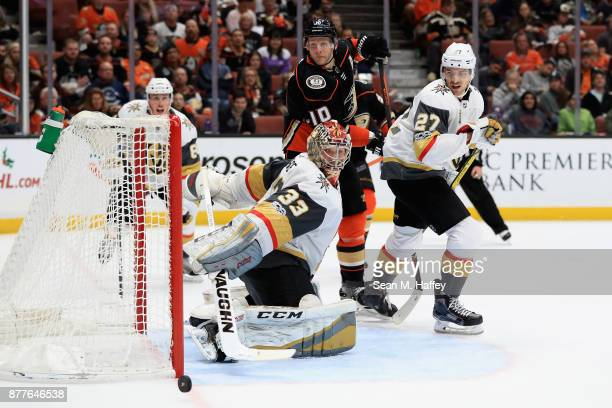 Corey Perry of the Anaheim Ducks looks on as Shea Theodore and Maxime Lagace of the Vegas Golden Knights block a shot on goal during the third period...