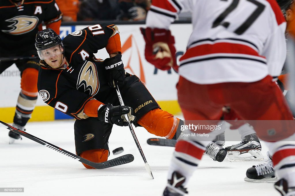 Corey Perry #10 of the Anaheim Ducks passes the puck from his knees during the third period of a game at Honda Center on December 11, 2015 in Anaheim, California.