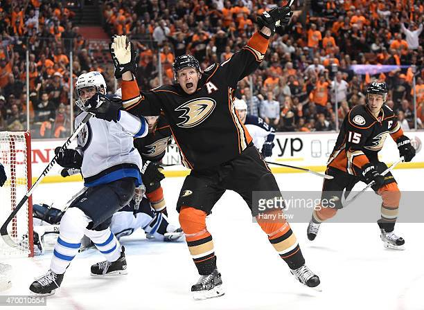 Corey Perry of the Anaheim Ducks reacts to his goal in front of Blake Wheeler of the Winnipeg Jets during the third period in Game One of the Western...