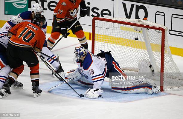 Corey Perry of the Anaheim Ducks scores a goal as Mark Fayne of the Edmonton Oilers and Anders Nilsson of the Edmonton Oilers defend during the third...