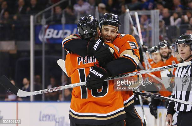 Corey Perry of the Anaheim Ducks scores at 11:16 of the first period against the New York Rangers and is embraced by Clayton Stoner at Madison Square...