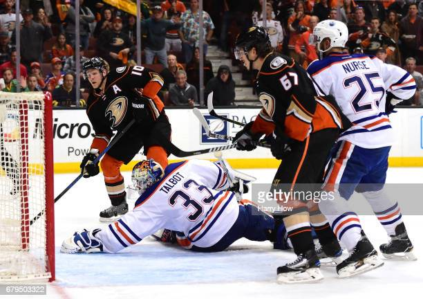 Corey Perry of the Anaheim Ducks scores on Cam Talbot of the Edmonton Oilers for a 43 win during the second overtime period in Game Five of the...