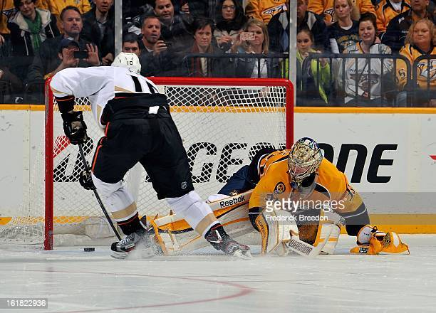 Corey Perry of the Anaheim Ducks scores the eventual gamewinning shootout goal against goalie Pekka Rinne of the Nashville Predators at the...