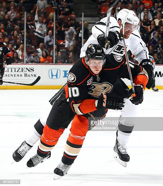 Corey Perry of the Anaheim Ducks skates against Jeff Schultz of the Los Angeles Kings in Game Seven of the Second Round of the 2014 Stanley Cup...