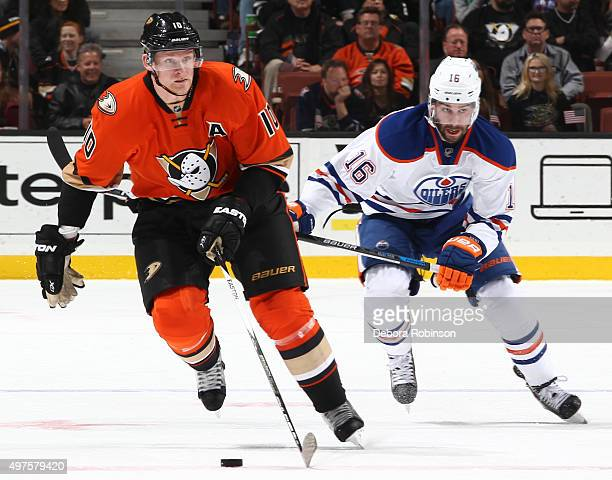 Corey Perry of the Anaheim Ducks skates with the puck against Teddy Purcell of the Edmonton Oilers on November 11 2015 at Honda Center in Anaheim...