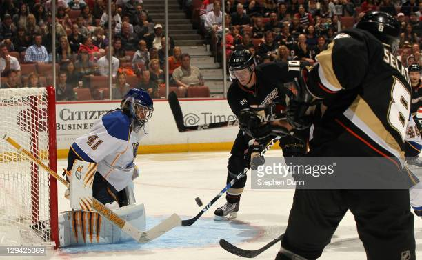 Corey Perry of the Anaheim Ducks takes a pass from Teemu Selanne and puts it past goalie Jaroslav Halak of the St. Louis Blues to score the Ducks'...