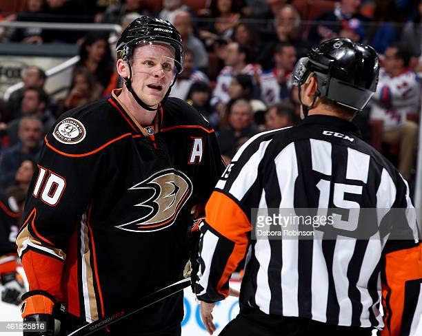 Corey Perry of the Anaheim Ducks talks with referee Stephane Auger during the game against the New York Rangers on January 7 2015 at Honda Center in...