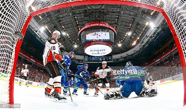 Corey Perry of the Anaheim Ducks watches a shot by Sami Vatanen of the Ducks beat Ryan Miller of the Vancouver Canucks for a goal during their NHL...