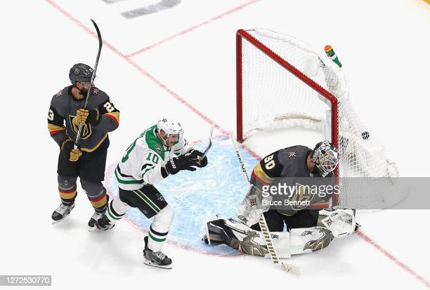 Corey Perry of the Dallas Stars celebrates as the game-winning goal by teammate Denis Gurianov goes past Robin Lehner of the Vegas Golden Knights to...