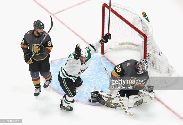 Corey Perry of the Dallas Stars celebrates as the gamewinning goal by teammate Denis Gurianov goes past Robin Lehner of the Vegas Golden Knights to...