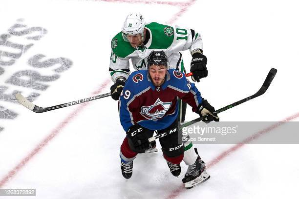 Corey Perry of the Dallas Stars checks Samuel Girard of the Colorado Avalanche during the first period in Game Two of the Western Conference Second...