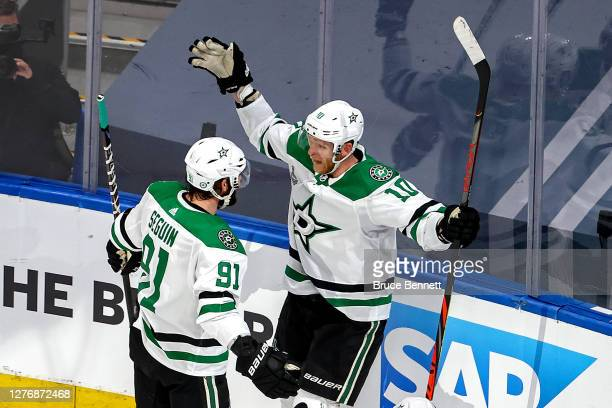 Corey Perry of the Dallas Stars is congratulated by Tyler Seguin after scoring a goal against the Tampa Bay Lightning during the first period in Game...