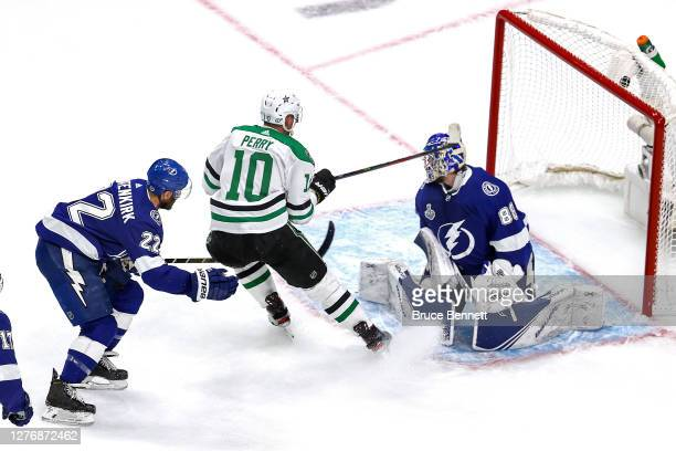 Corey Perry of the Dallas Stars scores a goal past Andrei Vasilevskiy of the Tampa Bay Lightning during the first period in Game Five of the 2020 NHL...