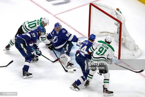 Corey Perry of the Dallas Stars scores the game-winning goal past Andrei Vasilevskiy of the Tampa Bay Lightning during the second overtime period to...