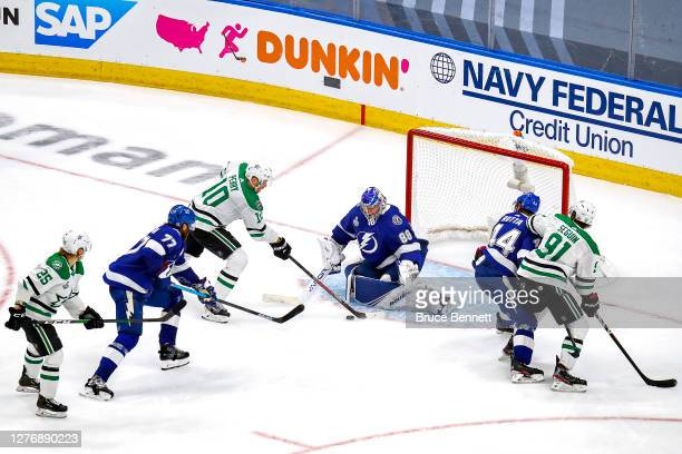 Corey Perry of the Dallas Stars scores the gamewinning goal past Andrei Vasilevskiy of the Tampa Bay Lightning during the second overtime period to...