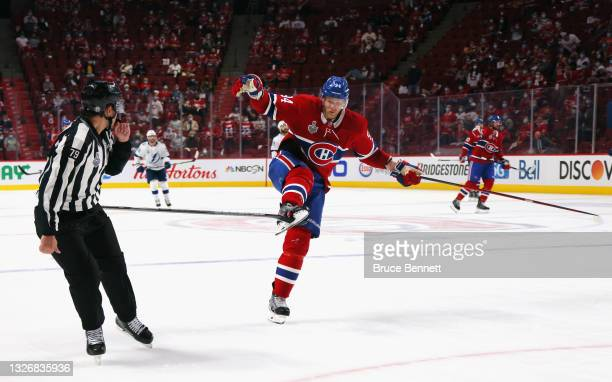 Corey Perry of the Montreal Canadiens gets Victor Hedman's of the Tampa Bay Lightning stick caught in his skates during Game Three of the 2021 NHL...