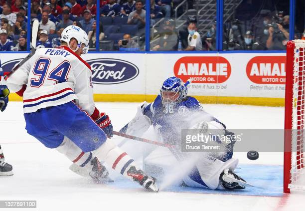 Corey Perry of the Montreal Canadiens is stopped by Andrei Vasilevskiy of the Tampa Bay Lightning in Game Five of the 2021 NHL Stanley Cup Final at...