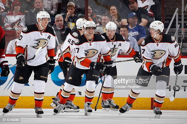 Corey Perry Sami Vatanen David Perron Cam Fowler and Rickard Rakell of the Anaheim Ducks react after scoring against the Arizona Coyotes during the...