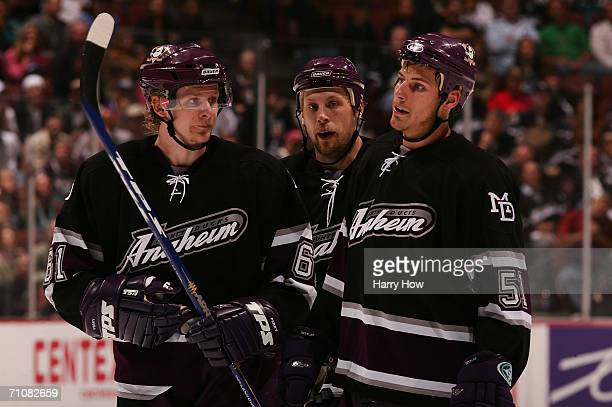 Corey Perry Travis Moen and Ryan Getzlaf of the Mighty Ducks of Anaheim look on during a break in game action against the Edmonton Oilers during game...