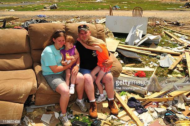 Corey Plunkett with his wife Lindsay and daughters Latasha and Makala The Plunketts remember the tornado that destroyed their home in Raisnville AL...