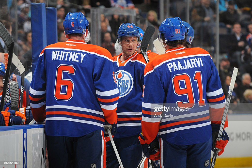Corey Potter #44, Ryan Whitney #6 and Magnus Paajarvi #91 of the Edmonton Oilers exchange words between plays in a game against the Colorado Avalanche at Rexall Place on January 28, 2013 in Edmonton, Alberta, Canada.