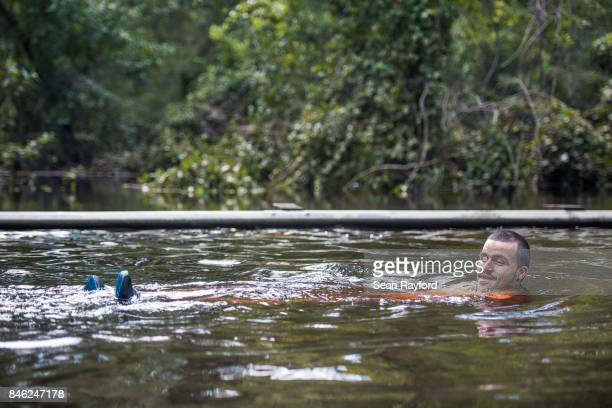 Corey Rivera takes a swim in flood waters on Thunder Rd caused by Hurricane Irma September 12 2017 in Middleburg Florida United States The storm...