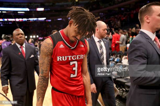 Corey Sanders of the Rutgers Scarlet Knights exits the court after falling to the Purdue Boilermakers 8275 during quarterfinals of the Big Ten...