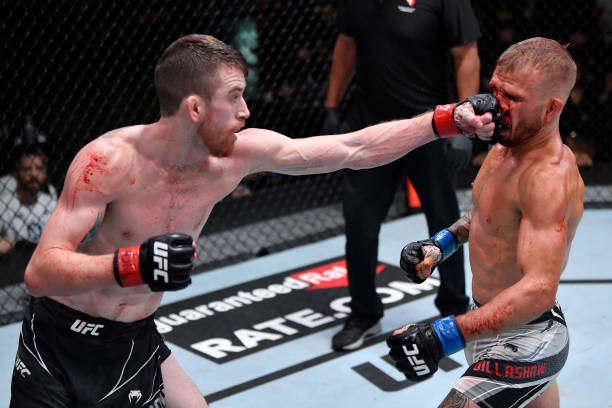 Corey Sandhagen punches T.J. Dillashaw in their bantamweight fight during the UFC Fight Night event at UFC APEX on July 24, 2021 in Las Vegas, Nevada.