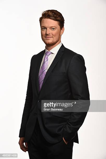 Corey Schneider of the New Jersey Devils poses for pictures at the NHL Player Media Tour at the Ritz Carlton on September 9 2015 in Toronto Ontario