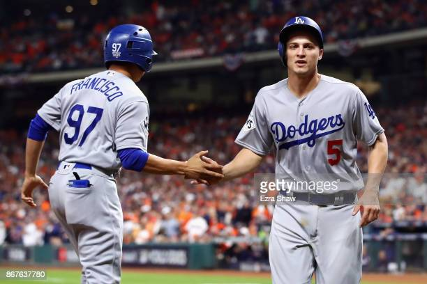 Corey Seager of the Los Angeles Dodgers celebrates after scoring on a RBI double by Cody Bellinger during the ninth inning against the Houston Astros...