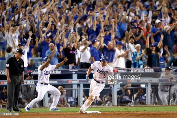 Corey Seager of the Los Angeles Dodgers celebrates as he runs the bases after hitting a tworun home run during the sixth inning against the Houston...
