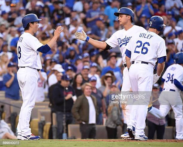 Corey Seager of the Los Angeles Dodgers celebrates his three run homerun with Kenta Maeda and Chase Utley for a 60 lead over the Arizona Diamondbacks...