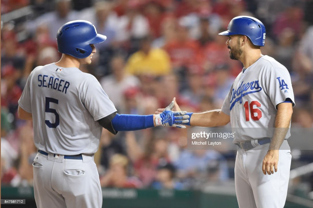Corey Seager #5 of the Los Angeles Dodgers celebrates with Andre Ethier #16 after hitting a three-run home run in the third inning against the Washington Nationals at Nationals Park on September 15, 2017 in Washington, DC.
