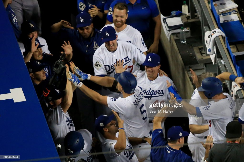 Corey Seager #5 of the Los Angeles Dodgers celebrates with teammates in the dugout after hitting a two-run home run during the sixth inning against the Houston Astros in game two of the 2017 World Series at Dodger Stadium on October 25, 2017 in Los Angeles, California.