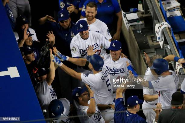 Corey Seager of the Los Angeles Dodgers celebrates with teammates in the dugout after hitting a tworun home run during the sixth inning against the...