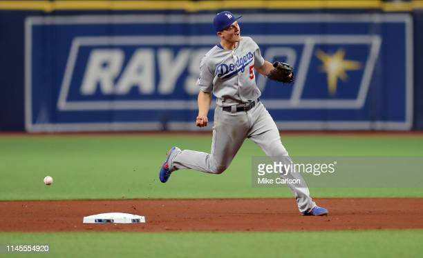 Corey Seager of the Los Angeles Dodgers drops a ground ball off the bat of Daniel Robertson of the Tampa Bay Rays in the fourth inning at Tropicana...