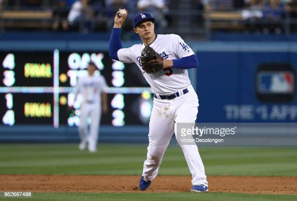 Corey Seager of the Los Angeles Dodgers fields a ground ball to short stop in the seventh inning during the MLB game against the Miami Marlins at...