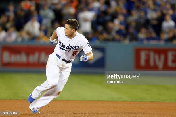 Corey Seager of the Los Angeles Dodgers heads back to first base after hitting a single in the third inning during Game 7 of the 2017 World Series...